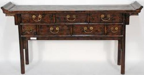 The rugged wood on this antique Chinese console or altar table is the focal