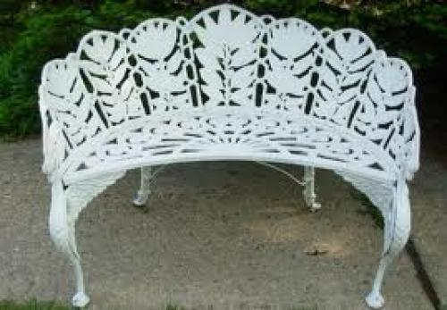 Antique; A Laurel Pattern Garden Bench, by Molla in cast aluminum dating from 1940
