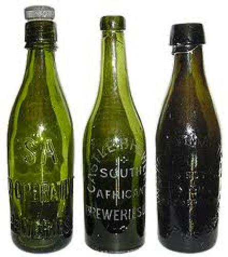 Bottles and Cans; The 2 left hand bottles were dug from a 1894 dump 