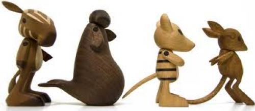 Handcrafted wooden toys of recently extinct animals.