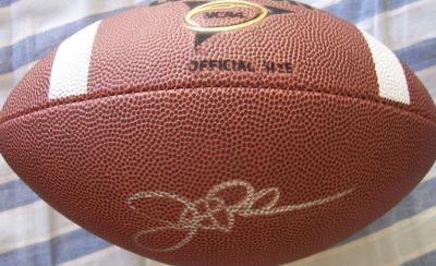 John Robinson (USC) autographed Wilson NCAA football