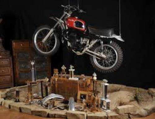 The McQueen Husqvarna and many items of memorabilia