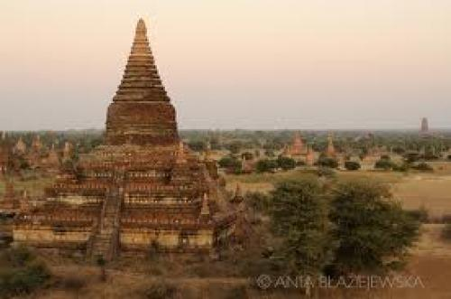 Postcard from Bagan. Myanmar, Bagan. Old temples after sunset.