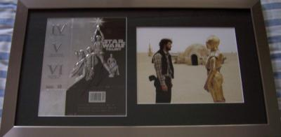 George Lucas autographed Star Wars Trilogy DVD box cover framed with photo