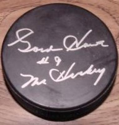 Gordie Howe autographed puck inscribed Mr. Hockey